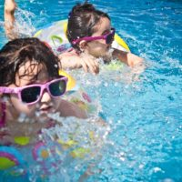 kids swimming in a pool